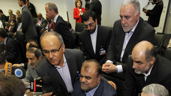 Iran's Minister of Petroleum Rostam Ghasemi, center, is surrounded by delegates and media prior to the start of the meeting of the Organization of the Petroleum Exporting Countries, OPEC, at their headquarters in Vienna, Austria, on Thursday, June 14, 2012. The meeting of the 12 oil ministers of the OPEC focuses on price and production targets. (AP Photo/Ronald Zak)