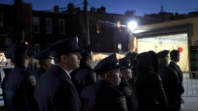 Police officers line up after sunset to attend the wake of slain NYPD officer Rafael Ramos at Christ Tabernacle Church in the Queens borough of New York
