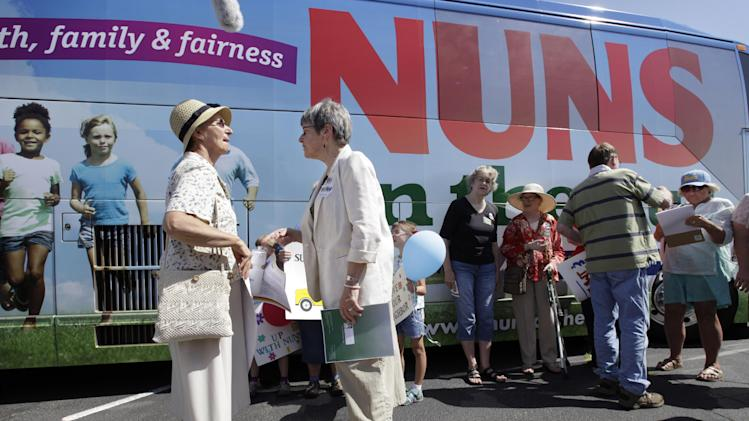 Sister Simone Campbell, right, executive director of Network, talks with Sister Lorraine Schmaltz, of Ames, Iowa, left, during a stop on the first day of a 9-state Nuns on the Bus tour, Monday, June 18, 2012, in Ames, Iowa. The group of Roman Catholic nuns say they're not opposing any particular candidate but that their fight is with a Republican proposed federal budget they say hurts the poor and needy. (AP Photo/Charlie Neibergall)