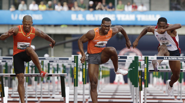 Joel Brown, Tyron Akins, and Ryan Fontenot compete in the men's 110 meter hurdles qualifying round at the U.S. Olympic Track and Field Trials Friday, June 29, 2012, in Eugene, Ore. (AP Photo/Eric Gay)