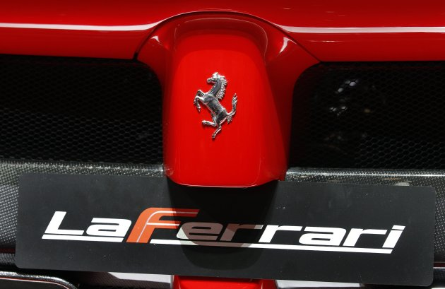 The back of the new LaFerrari hybrid car is uncovered on the Ferrari stand during the first media day of the 83rd Geneva Car Show at the Palexpo Arena in Geneva