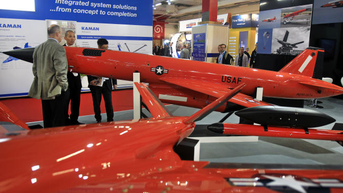 Visitors look at aerial target drones Firejet, foreground and BQM.167A, made by U.S. company BEI, at the U.S. pavilion, on the first day of the Paris Air Show at Le Bourget airport, north of Paris, Monday June 17, 2013. (AP Photo/Remy de la Mauviniere)