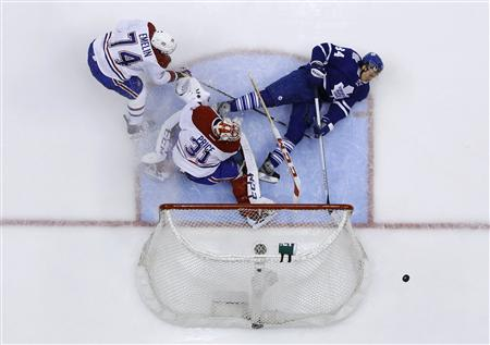 Toronto Maple Leafs' Grabovski crashes towards net against Montreal Canadiens' Price and Emelin during their NHL hockey game in Toronto