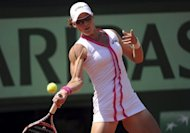 Australia's Samantha Stosur hits a return to Britain's Elena Baltacha after winning their Women's Singles 1st Round tennis match of the French Open tennis tournament at the Roland Garros stadium, in Paris. Stosur, the 2010 runner-up to Francesca Schiavone, took just over an hour to see off the 68th-ranked Baltacha 6-4, 6-0
