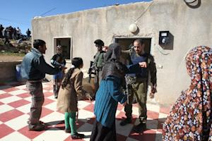 A Palestinian family argues with members of the Israeli…