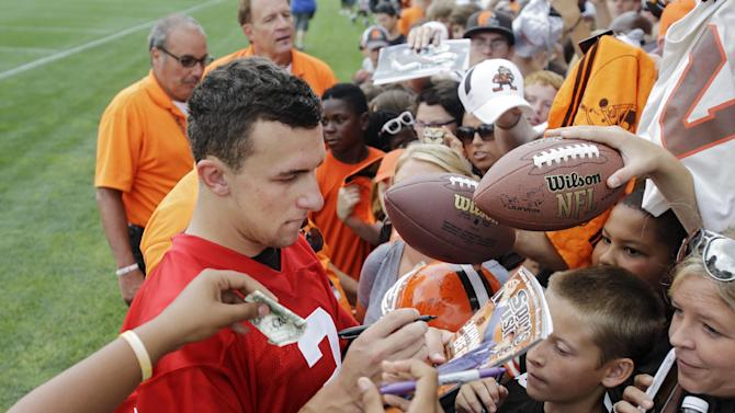 Fans are watching in record numbers to see if Johnny Manziel earns Cleveland's starting quarterback job. (AP Photo)