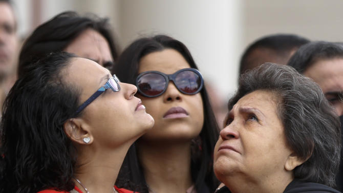 Mother Elena Frias and daughters Rosa Virginia and Maria Gabriela commemorate anniversary of Hugo Chavez's death in Caracas