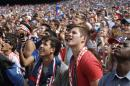 Fans watch as Belgium scores against the U.S. during the Brazil 2014 World Cup viewing party at Solider Field on Tuesday, July 1, 2014 in Chicago. Belgium defeated the U.S. 2-1. (AP Photo/Stacy Thacker)