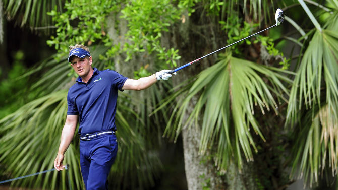 Luke Donald, of England, points with his driver where his ball is landing on the fifth fairway during the final round of the RBC Heritage golf tournament in Hilton Head Island, S.C., Sunday, April 15, 2012. (AP Photo/Stephen Morton)