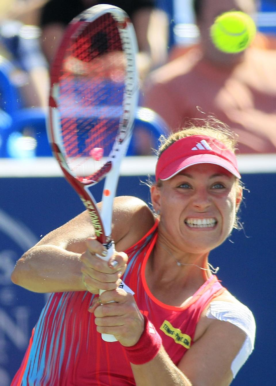 Angelique Kerber, from Germany, hits a shot against Serena Williams during a quarterfinal at the Western & Southern Open tennis tournament, Friday, Aug. 17, 2012, in Mason, Ohio. Kerber won 6-4, 6-4. (AP Photo/Al Behrman)