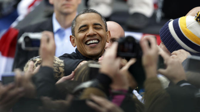President Barack Obama greets supporters during a campaign event near the State Capitol Building in Madison, Wis., Monday, Nov. 5, 2012. (AP Photo/Pablo Martinez Monsivais)