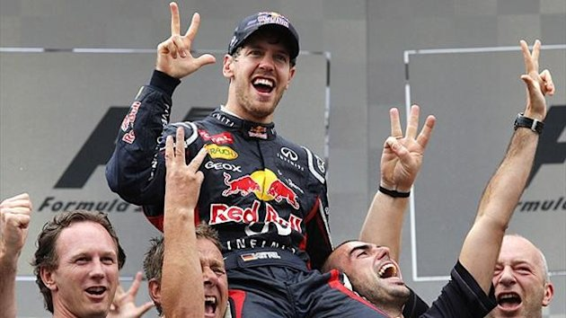 Red Bull's Sebastian Vettel celebrates his third world title (Reuters)
