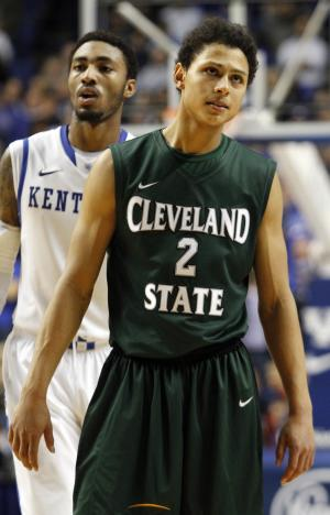 Cleveland State's Bryn Forbes (2) looks dejectedly at the score board late in the second half of an NCAA college basketball game against Kentucky, Monday, Nov. 25, 2013, in Lexington, Ky. Kentucky won 68-61