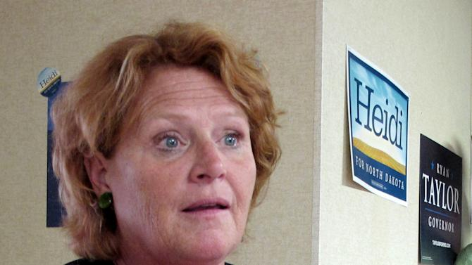 FILE -This photo Aug. 11, 2012 file photo shows North Dakota Senate candidate Heidi Heitkamp speaking in Dickinson, N.D. Senate Democrats are launching two ads in North Dakota criticizing Republican Rep. Rick Berg over the stalled farm bill. Berg is locked in a close race with Heitkamp for the open seat.  (AP Photo/Dale Wetzel, File )