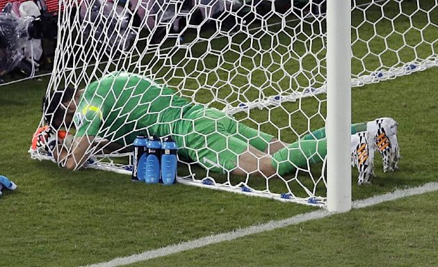 Greece's goalkeeper Orestis Karnezis sits in the net during the group C World Cup soccer match between Japan and Greece at the Arena das Dunas in Natal, Brazil, Thursday, June 19, 2014. (AP Photo/Hassan Ammar)