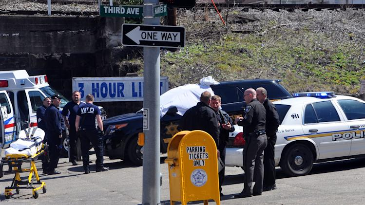 Law enforcement officers and emergency service personnel converge on the scene of the shooting in downtown Williamson, W.Va., Wednesday, April 3, 2013, where Sheriff Eugene Crum was shot and killed at point blank range. (AP Photo/Williamson Daily News, Kyle Lovern)