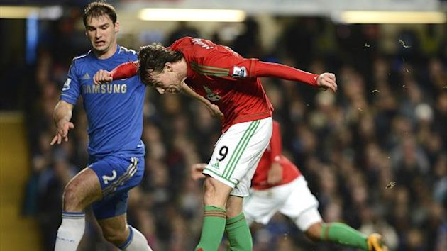 Swansea City's Michu (R) shoots and scores as Chelsea's Branislav Ivanovic challenges (Reuters)