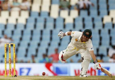Australia's Warner avoids being run out by South Africa's Philander during the third day of their cricket test match in Centurion