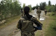 Afghan army soldiers and US soldiers patrol Sabari district in Khost province. Taliban Islamist insurgents beheaded 17 party-goers, 10 Afghan soldiers were killed and two NATO troops shot dead in a new insider attack in a bloody day across Afghanistan, officials said Monday