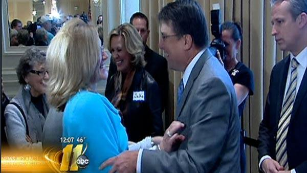 New governor greeted with smiles, handshakes