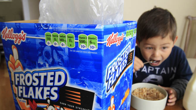 FILE - Nathaniel Donaker, 4, eats Kellogg's Frosted Flakes cereal at his home in Palo Alto, Calif., Thursday, April 28, 2011. Tony the Tiger and Toucan Sam can rest easy. Government officials fine-tuning guidelines for marketing food to children say they won't push the food industry to get rid of colorful cartoon characters on cereal boxes anytime soon. The food industry, backed by House Republicans, who are holding a hearing on the issue Wednesday, Oct. 12, 2011 has aggressively lobbied against the voluntary guidelines, saying they are too broad and would limit marketing of almost all of the nation's favorite foods, including some yogurts and many children's cereals.   (AP Photo/Paul Sakuma)