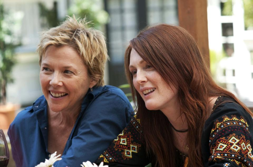 "FILE - In this publicity image released by Focus Features, Annette Bening, left, and Julianne Moore are shown in a scene from ""The Kids are All Right."" (AP Photo/Focus Features, Suzanne Tenner, File)"