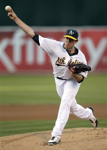 A's win again in 15th, outlast Toronto 5-4