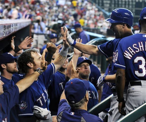 Lewis shuts down Astros, has 2 RBI to lift Rangers