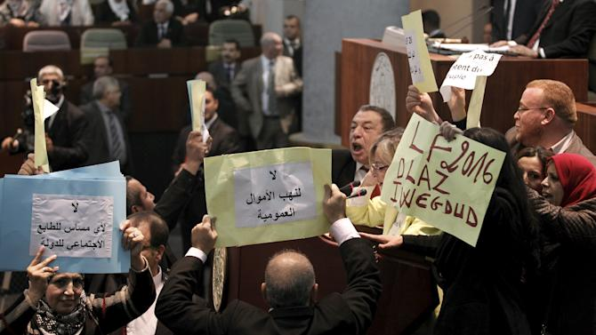 Algerian opposition MPs invade the hemicycle to prevent the voting of the Finance Bill 2016 at the Algerian People's National Assembly (APN) in Algiers, Algeria