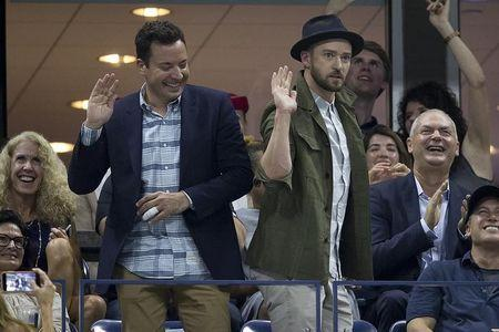 Television personality Fallon and actor and singer Timberlake play around as they attend the quarterfinals match between Federer of Switzerland and Gasquet of France at the U.S. Open Championships tennis tournament in New York
