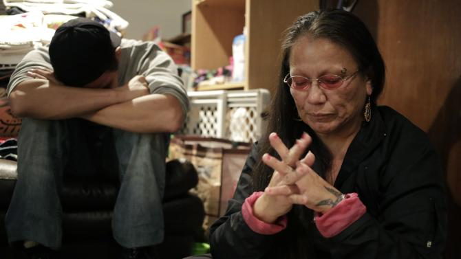 Paula Hatch and her son Brandon Hatch are overcome with emotion during an interview day after several of their relatives were involvedin a shooting at Marysville-Pilchuck High School in Marysville