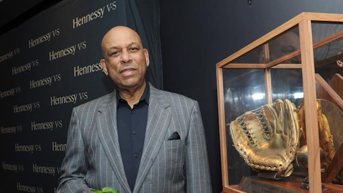 IMAGE DISTRIBUTED FOR HENNESSY V.S - Baseball Hall of Famer Orlando Cepeda poses with Roberto Clemente's 1966 Gold Glove during a Hennessy V.S event to celebrate the history of Latinos in baseball at the Parlor in New York, Thursday, June 27, 2013. (Photo by Diane Bondareff/Invision for Hennessy V.S/AP Images)
