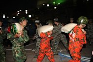 Rescuers unload supplies at an emergency relief centre in Yiliang on September 8. A spokesman with the provincial civil affairs department meanwhile warned the death toll could climb further because impassable roads and downed communications were making it difficult to collect information