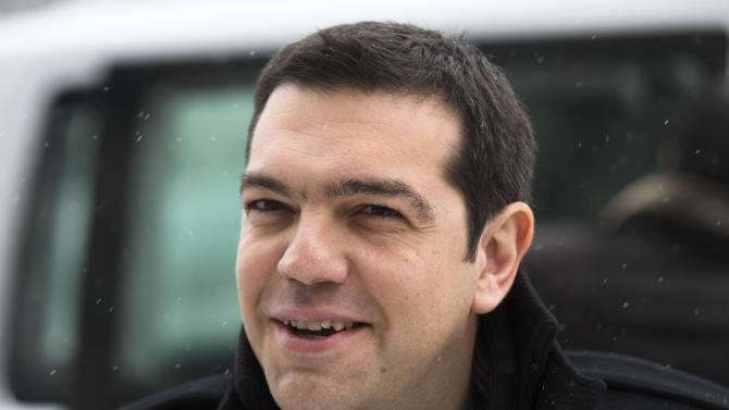 Greek left wing politician and party leader Alexis Tsipras arrives at the German Finance Ministry for a closed meeting with Finance Minister Wolfgang Schaeuble in Berlin, Monday, Jan. 14, 2013. (AP Photo/Markus Schreiber)
