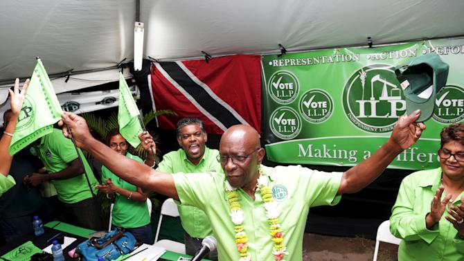 Former FIFA Vice President Jack Warner gestures while surrounded by supporters during a political rally organised by his Independent Liberal Party in Chaguanas