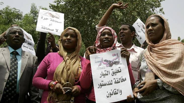 "Sudanese journalists hold slogans which reads in Arabic ""Press freedom or no press"" at Sudanese Journalists Union's office in the capital Khartoum on July 17, 2012"