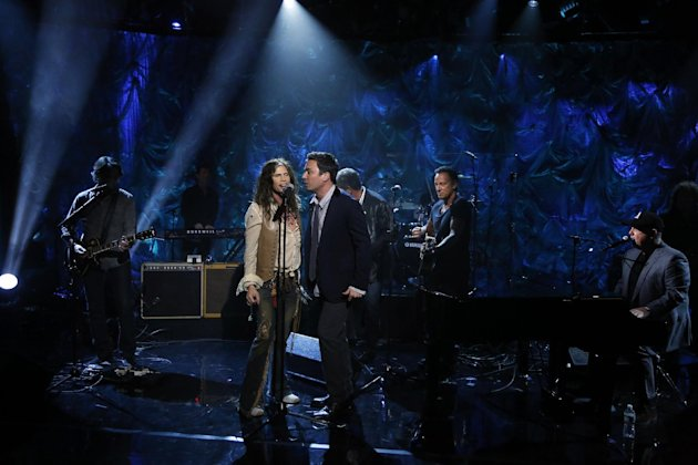 In this photo provided by NBC, from second left, Steven Tyler, Jimmy Fallon, Bruce Springsteen and Billy Joel perform during &quot;Hurricane Sandy: Coming Together&quot; Friday, Nov. 2, 2012, in New York. Hosted by Matt Lauer, the event is heavy on stars identified with New Jersey and the New York metropolitan area, which took the brunt of this week&#39;s deadly storm. (AP Photo/NBC, Heidi Gutman)
