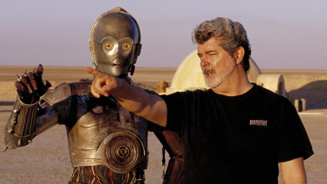 "** FILE ** In this undated publicity photo released by Lucasfilm Ltd. & TM, director George Lucas directs actor Anthony Daniels, who plays the robot C-3PO, in ""Star Wars II: Attack of the Clones,"" on location in the Tunisian desert.  Lucasfilm said in a statement Monday, Jan. 28, 2013, that it's postponing the scheduled fall 3-D releases of ""Star Wars: Episode II - Attack Of The Clones"" and ""Episode III - Revenge of the Sith"" to instead focus its efforts on ""Star Wars: Episode VII.""   (AP Photo/Lucasfilm Ltd. & TM, Lisa Tomasetti, file)"
