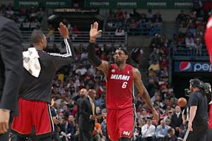 James leads Heat over Bucks and into next round