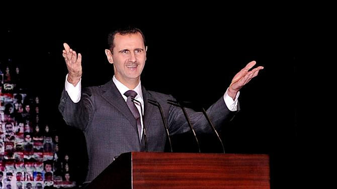 """FILE - In this Sunday, Jan. 6, 2013 file photo released by the Syrian official news agency SANA, Syrian President Bashar Assad gestures speaks at the Opera House in central Damascus, Syria. Assad has warned that the fall of his regime or the  breakup of Syria will unleash a wave of instability that will shake the Middle East for years to come. Assad told the Turkish TV station Ulusal Kanal in an interview aired Friday, April 5, 2013 that """"we are surrounded by countries that help terrorists and allow them to enter Syria."""" (AP Photo/SANA, File)"""