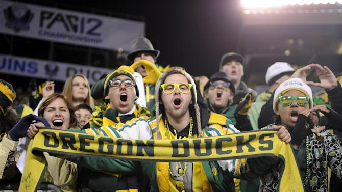 Oregon fans celebrate a score against UCLA in the first half of the NCAA Pac-12 Championship college football game in Eugene, Ore., Saturday, Dec 2, 2011. (AP Photo/Greg Wahl-Stephens)
