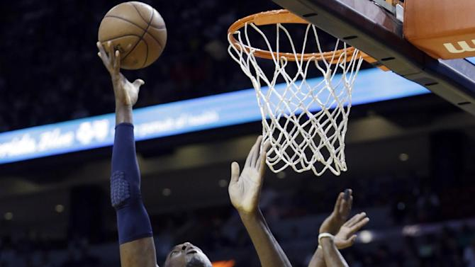 Indiana Pacers' Roy Hibbert (55) goes up to the basket as Miami Heat's Mario Chalmers (15) defends during the first half of an NBA basketball game in Miami, Sunday, March 10, 2013. (AP Photo/Alan Diaz)