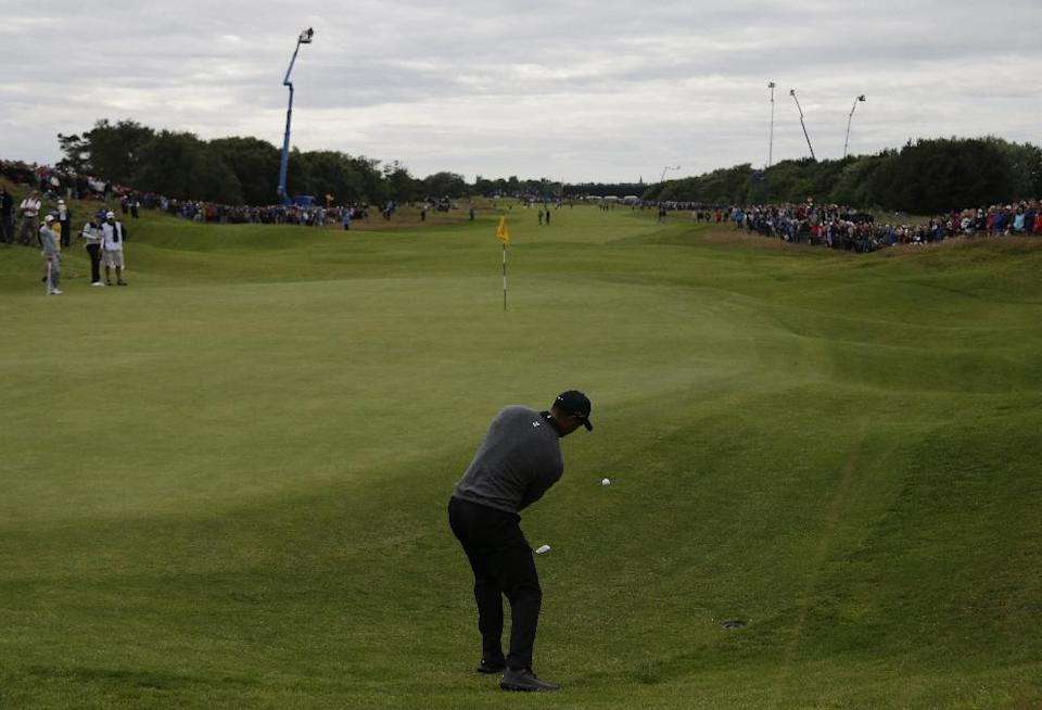 Tiger Woods of the United States plays a shot onto the seventh green at Royal Lytham & St Annes golf club during the second round of the British Open Golf Championship, Lytham St Annes, England, Friday, July 20, 2012. (AP Photo/Chris Carlson)
