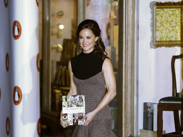 "Pippa Middleton, sister to the Duchess of Cambridge, formerly known as Kate Middleton, poses for the media as she arrives at a bookshop to promote her new book ""Celebrate: A Year of British festivitie"