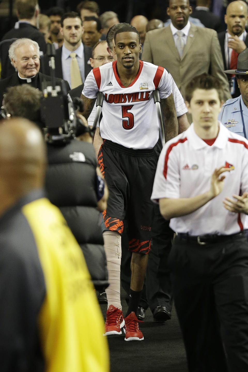 Fans cheer as Louisville's Kevin Ware takes to the court before the first half of the NCAA Final Four tournament college basketball semifinal game against Wichita State, Saturday, April 6, 2013, in Atlanta. (AP Photo/David J. Phillip)