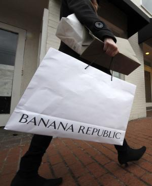 In this Feb. 14, 2011 photo, a shopper carries her purchases in the Shadyside section of Pittsburgh. The Consumer Confidence Index rose in February to its highest point in three years as consumers are feeling more positive about their income prospects and the direction the economy is headed. (AP Photo/Gene J. Puskar)