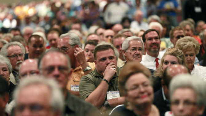 "In this June 19, 2012 photo, participants in the Southern Baptist Convention, listen during a debate about changing the name of the organization, at the convention in New Orleans. The nation's largest Protestant denomination has voted to adopt an alternative name for churches that feel the title ""Southern Baptist"" could be a turn-off to potential believers. Although the denomination's name will officially remain Southern Baptist Convention, many delegates still opposed the optional ""Great Commission Baptists.""  (AP Photo/Gerald Herbert)"