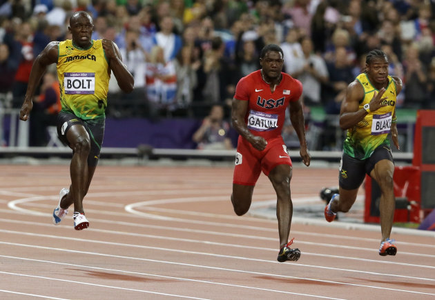 Jamaica's Usain Bolt, left, prepares to pass United States' Justin Gatlin, center,  and Jamaica's Yohan Blake, to win in the men's 100-meter final during the athletics in the Olympic Stadium at the 20