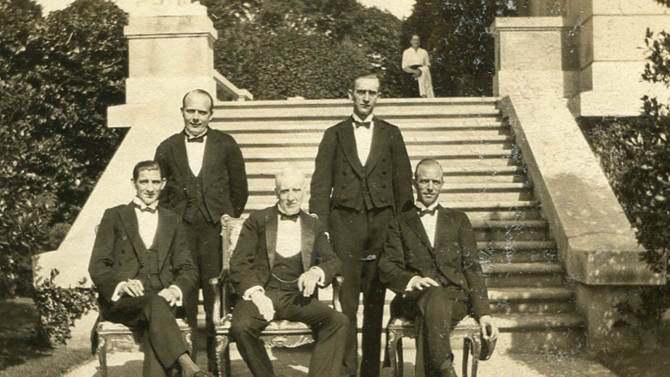 """This circa 1920s photo provided by The Preservation Society of Newport County shows butler Ernest Birch, center, surrounded by footmen next to the terrace of The Elms mansion in Newport, R.I.  Newly discovered photographs, documents and family histories have inspired the creation of a tour about servants at The Elms, echoing themes of the British drama program, """"Downton Abbey.""""  (AP Photo/The Preservation Society of Newport County)"""