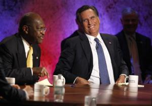 Republican presidential hopeful businessman Herman Cain speaks as former Massachusetts Governor Mitt Romney laughs at the Republican presidential debate at Dartmouth College in Hanover, New Hampshire